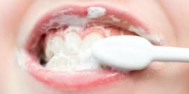 a kids mouth during teeth brushing, macro